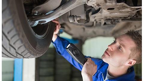 Vehicle Technician servicing a car.