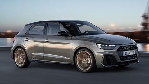 Grey Audi A1, driving