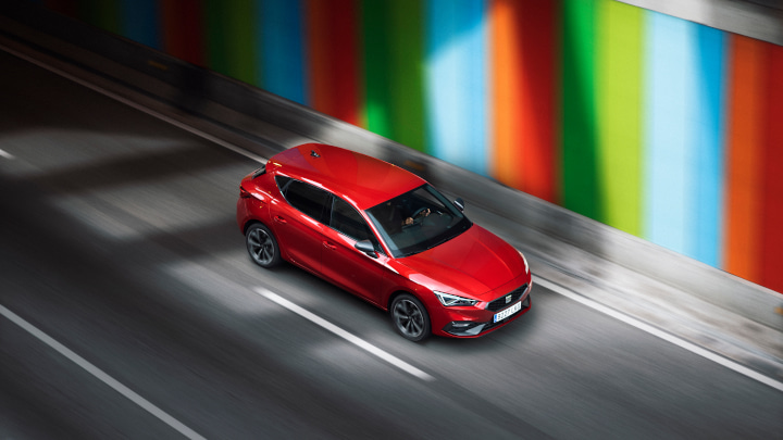 Red SEAT Leon Driving