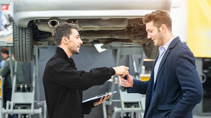 Vauxhall technician handing keys to customer