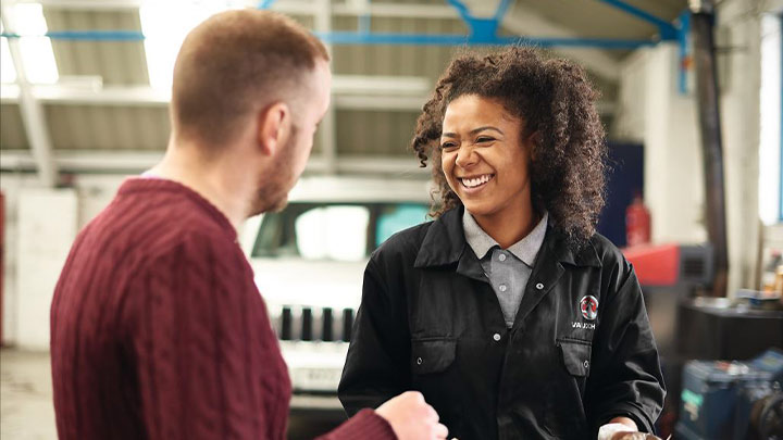 Vauxhall technician talking to a customer
