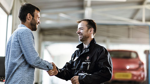Vauxhall technician greeting customer