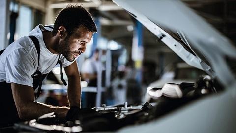 Vauxhall technician looking under car bonnet