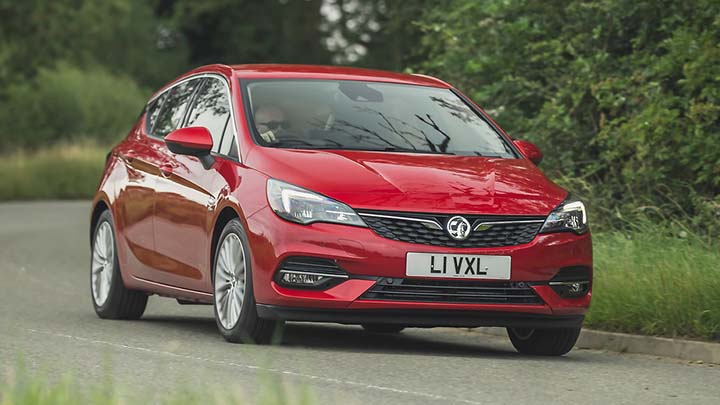 red vauxhall astra driving