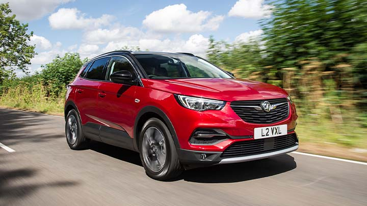 red vauxhall grandland x, driving in countryside