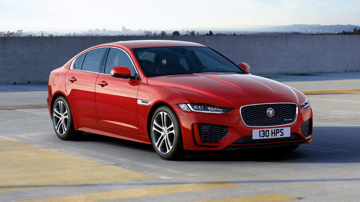 Jaguar XE in red parked.