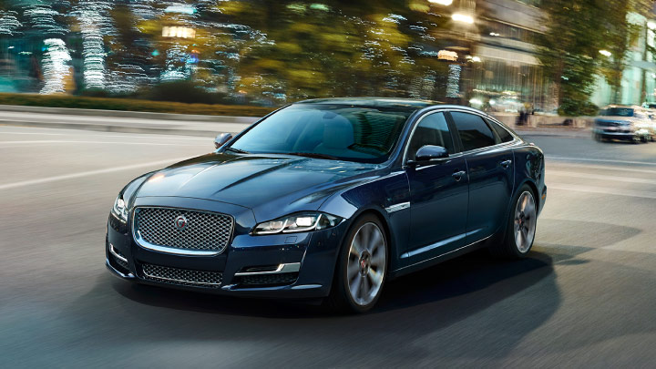 Jaguar XJ driving on the road.