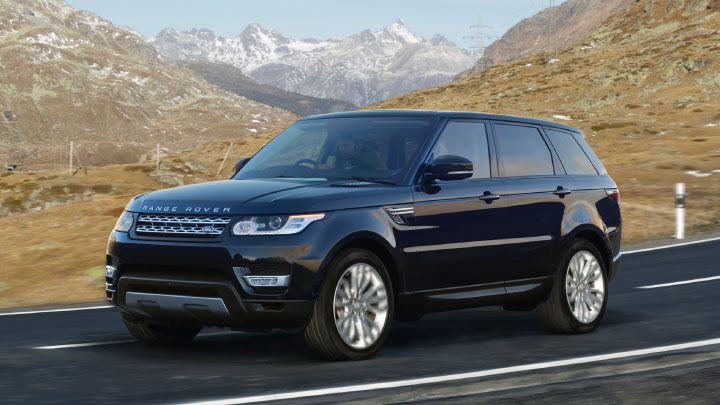 Land Rover Range Rover Sport in black on the road.