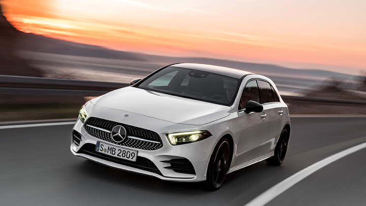 White Mercedes-Benz A-Class driving on the road.