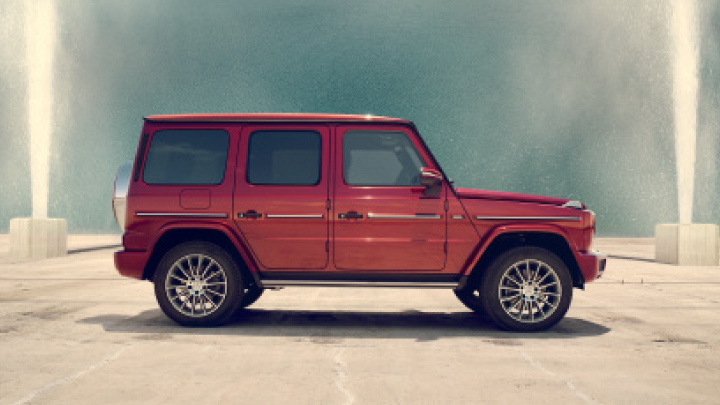 Side view of a red Mercedes-Benz G-Class.
