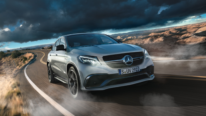 Silver Mercedes-Benz GLE-Coupe driving on the road.