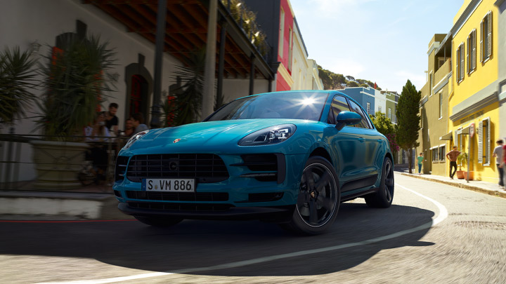 New blue Porsche Macan on the road.